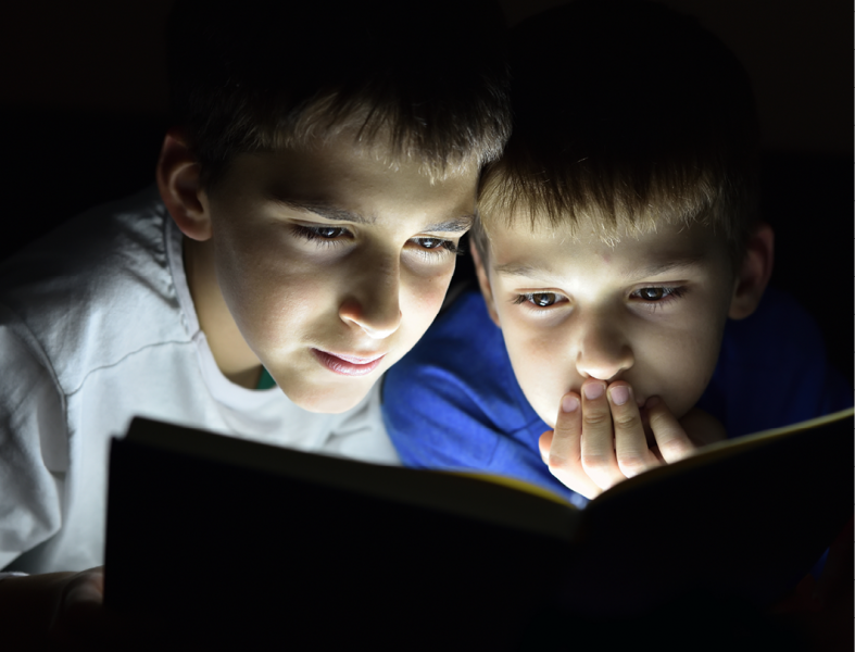Boys Reading by Flashlight.png